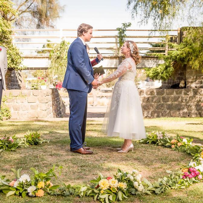 Tom & Libby say their vows.