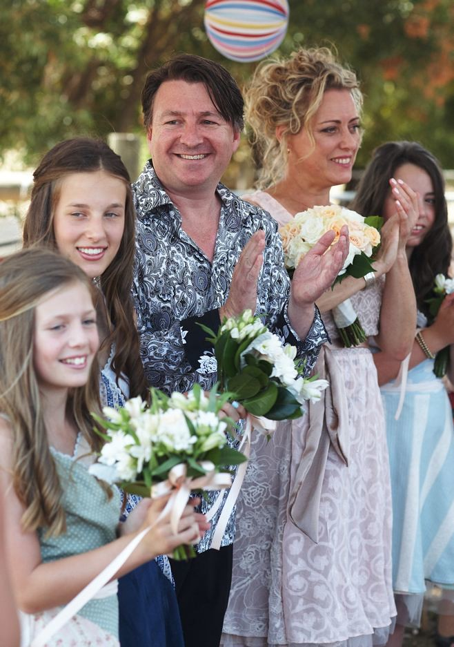 Lou, Mark and gorgeous family on their big day.